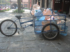 rickshaw(0.0), moped(0.0), sports equipment(0.0), bicycle(0.0), cart(0.0), wheel(1.0), vehicle(1.0), land vehicle(1.0), tricycle(1.0),