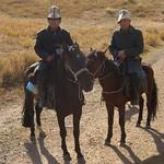 Kyrgyz Men with Kalpaks on Horses - Kyrgyzstan