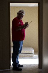 USACE inspector reviewing newly delivered temporary housing unit in Alabama