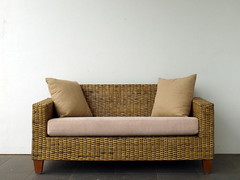 sofa bed(0.0), chair(0.0), furniture(1.0), brown(1.0), wood(1.0), loveseat(1.0), wicker(1.0), living room(1.0), couch(1.0), studio couch(1.0),
