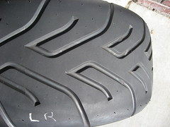 rim(0.0), bumper(0.0), tire(1.0), automotive tire(1.0), tire care(1.0), automotive exterior(1.0), wheel(1.0), tread(1.0),