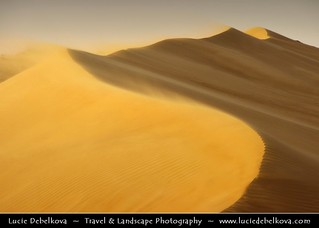 Oman - Wind blowing over Sand Dunes in Wahiba Sands