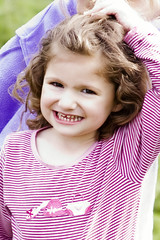 child, hairstyle, portrait photography, child model, purple, skin, girl, hair, laughter, person, pink, beauty, toddler, smile, eye, organ,