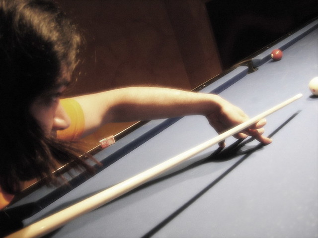 Pool Player Lining up Shot on Bar Pool Table