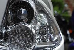 wheel(0.0), rim(0.0), spoke(0.0), automobile(1.0), vehicle(1.0), glass(1.0), headlamp(1.0), land vehicle(1.0),