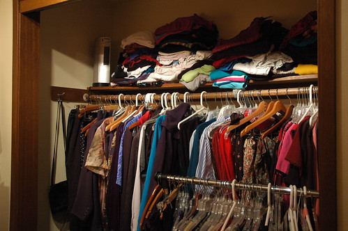 Clothes Closet, overstuffed with clothes, Greenwood, Seattle, Washington, USA