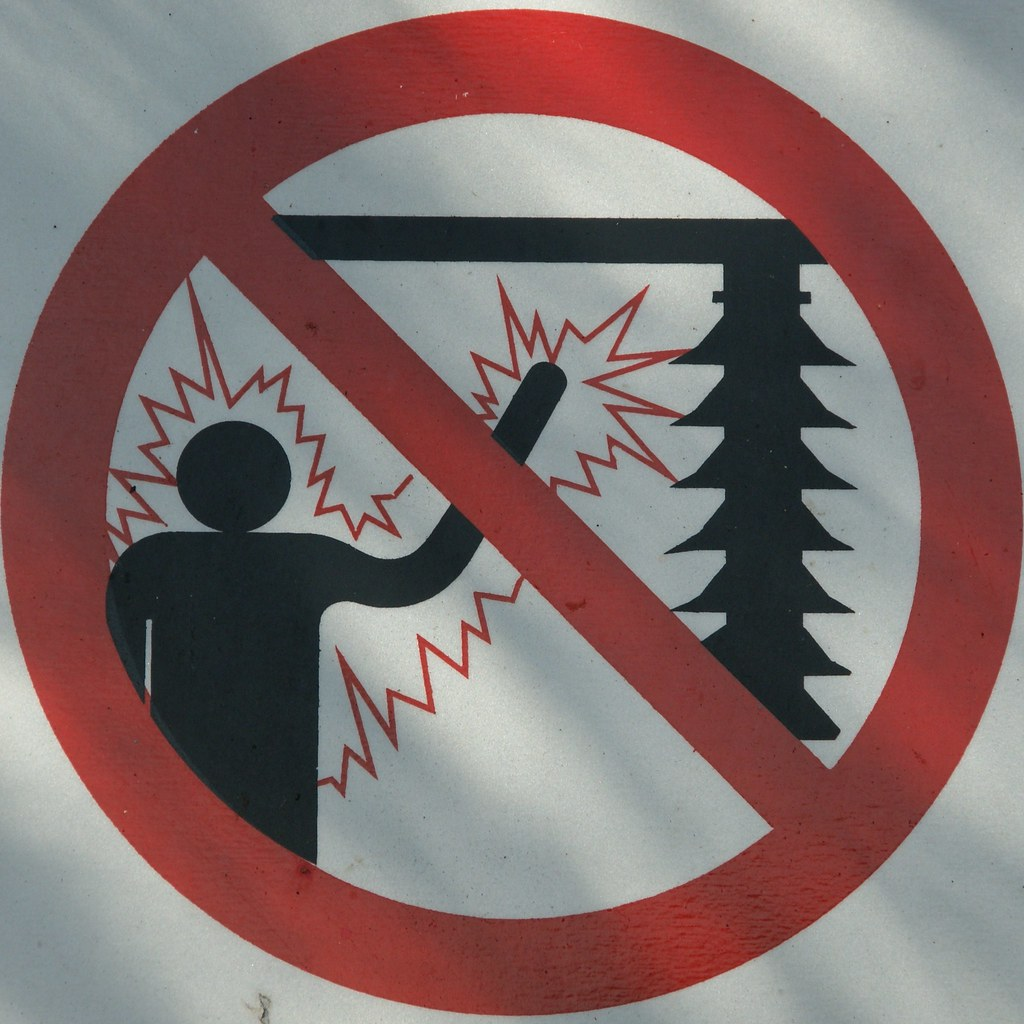A picture of a warning sign indicating danger of electric shocks