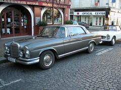 mercedes-benz w114(0.0), sedan(0.0), convertible(0.0), automobile(1.0), automotive exterior(1.0), vehicle(1.0), mercedes-benz w108(1.0), mercedes-benz(1.0), compact car(1.0), antique car(1.0), classic car(1.0), vintage car(1.0), land vehicle(1.0), luxury vehicle(1.0),