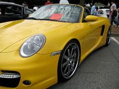 porsche boxster(0.0), automobile(1.0), automotive exterior(1.0), wheel(1.0), vehicle(1.0), performance car(1.0), automotive design(1.0), porsche(1.0), bumper(1.0), porsche carrera gt(1.0), land vehicle(1.0), luxury vehicle(1.0), convertible(1.0), supercar(1.0), sports car(1.0),