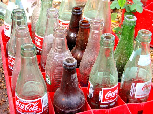 Empty Coke and soda bottles.