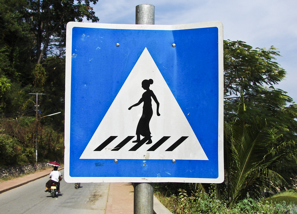 Women with sarongs crossing