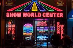 machine(0.0), slot machine(0.0), casino(0.0), signage(1.0), neon sign(1.0),
