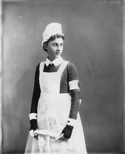 Young girl in Red Cross uniform