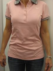 dress shirt(0.0), maroon(0.0), pocket(0.0), neck(1.0), clothing(1.0), collar(1.0), sleeve(1.0), polo shirt(1.0), t-shirt(1.0),