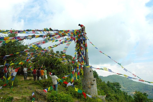 Putting up prayer flags on Pharping hilltop, Nepal by Wonderlane