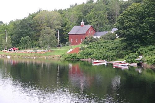 red white lake green water barn buildings boat maine sebek sebeklake stagedforblogging