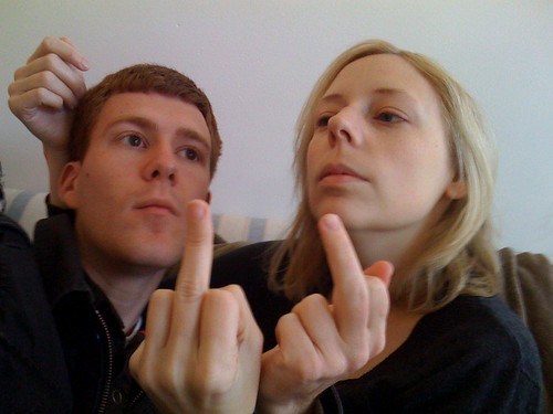 Nick and Melissa give you the finger and are a band