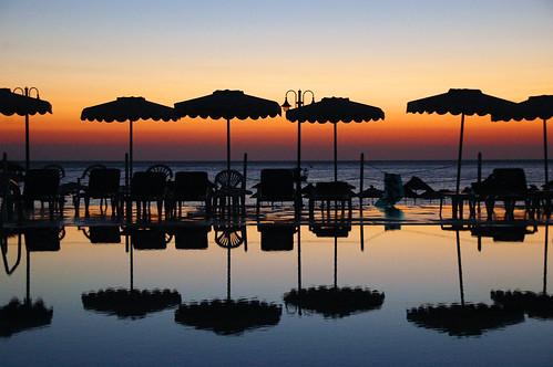 vacation sun holiday beach pool umbrella island coast europe nikond70 palm greece rodos rhodes lindos rhodos majka eow colorphotoaward superbmasterpiece diamondclassphotographer flickrdiamond goldstaraward unlimitedphotos kmecova lindosbayhotel
