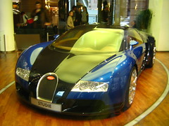 race car(1.0), automobile(1.0), bugatti(1.0), automotive exterior(1.0), wheel(1.0), vehicle(1.0), automotive design(1.0), auto show(1.0), bugatti veyron(1.0), land vehicle(1.0), luxury vehicle(1.0), supercar(1.0), sports car(1.0),