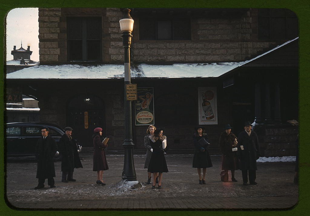 Commuters, who have just come off the train, waiting for the bus to go home, Lowell, Mass. (LOC)