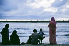 Muslim family at the beach