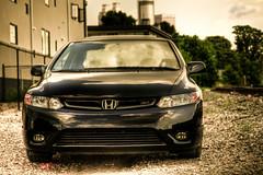 wheel(0.0), automobile(1.0), automotive exterior(1.0), vehicle(1.0), automotive design(1.0), honda(1.0), bumper(1.0), honda civic hybrid(1.0), land vehicle(1.0), luxury vehicle(1.0), honda civic(1.0),