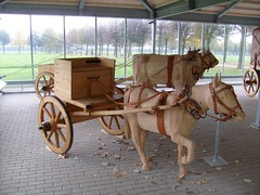 coachman(0.0), vehicle(1.0), pack animal(1.0), horse harness(1.0), horse and buggy(1.0), land vehicle(1.0), carriage(1.0), cart(1.0),