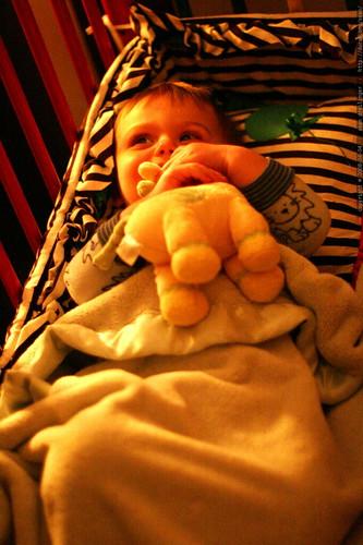 hugging his stuffed giraffe goodnight    MG 0837