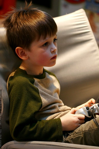 nick engrossed in a video game    MG 8940