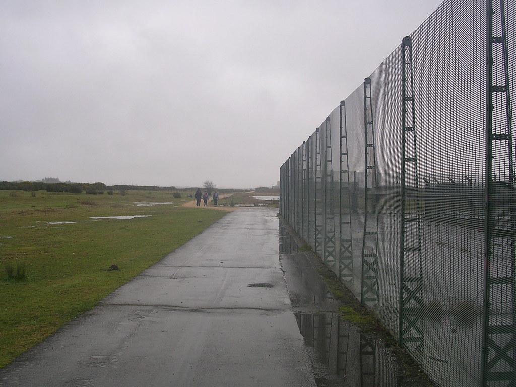 Along the fence Greenham Common Newbury Racecourse to Woolhampton