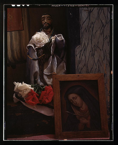 A Santo bulto and a painting of the Dolorosa in the church,  Trampas,  New Mexico (LOC)