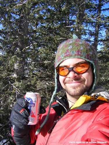 Jeremy enjoys a post-climb celebratory beer.