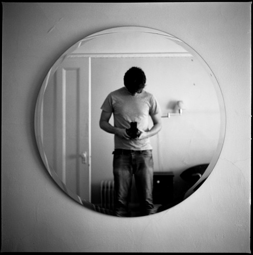 Self portrait in the round mirror