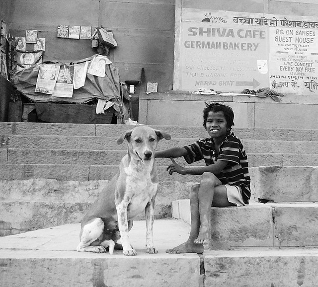 boy and his dog near assi ghat