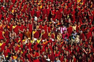 Tibetan Buddhist Entourage: The Sakya Family middle row, His Holiness Jigdal Dagchen Sakya, center, monks, nuns, on the steps of Tharlam Monastery of Tibetan Buddhism in Boudha, outside of Kathmandu, Nepal