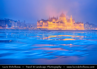 Hungary - Budapest - Hungarian Parliament Building - Iconic landmark reflected at Danube River full of floating ice