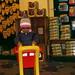 Small photo of Nitya busy shopping.
