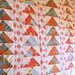 orange flying geese quilt