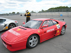 ferrari f430 challenge(0.0), ferrari f40(0.0), ferrari f355(0.0), ferrari testarossa(0.0), race car(1.0), automobile(1.0), vehicle(1.0), automotive design(1.0), ferrari 348(1.0), ferrari s.p.a.(1.0), land vehicle(1.0), luxury vehicle(1.0), supercar(1.0), sports car(1.0),