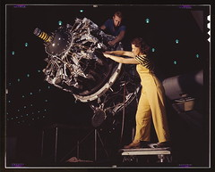 Women are trained to do precise and vital engine installation detail in Douglas Aircraft Company plants, Long Beach, Calif.  (LOC)