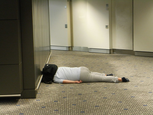 People Sleeping On The Airport Floor Like It Was A King