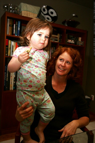 mikaela, standing on kathy's lap during breakfast    MG 1686