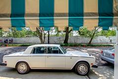rolls-royce corniche(0.0), compact car(0.0), convertible(0.0), automobile(1.0), automotive exterior(1.0), executive car(1.0), vehicle(1.0), rolls-royce silver shadow(1.0), performance car(1.0), antique car(1.0), sedan(1.0), vintage car(1.0), land vehicle(1.0), luxury vehicle(1.0),