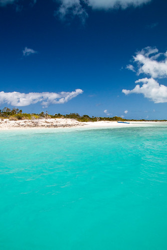 ocean blue beach water boat vehicle coastline turksandcaicosislands providenciales princessalexandralandandseanationalpark stubbscreek