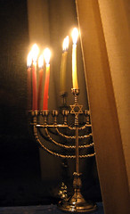 light fixture(0.0), street light(0.0), candle(1.0), menorah(1.0), light(1.0), candle holder(1.0), hanukkah(1.0), darkness(1.0), lighting(1.0),