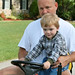 Small photo of Caden on Tractor