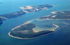 arctic ocean(0.0), lagoon(1.0), archipelago(1.0), estuary(1.0), atoll(1.0), cape(1.0), sea(1.0), bay(1.0), island(1.0), channel(1.0), aerial photography(1.0), spit(1.0), coast(1.0), islet(1.0),