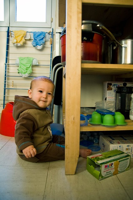 This kid doesn't need toys. He has tupperware and empty boxes. And he loves it!