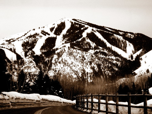 blue winter sky sun mountain snow ice field sepia fence town view hailey top idaho valley