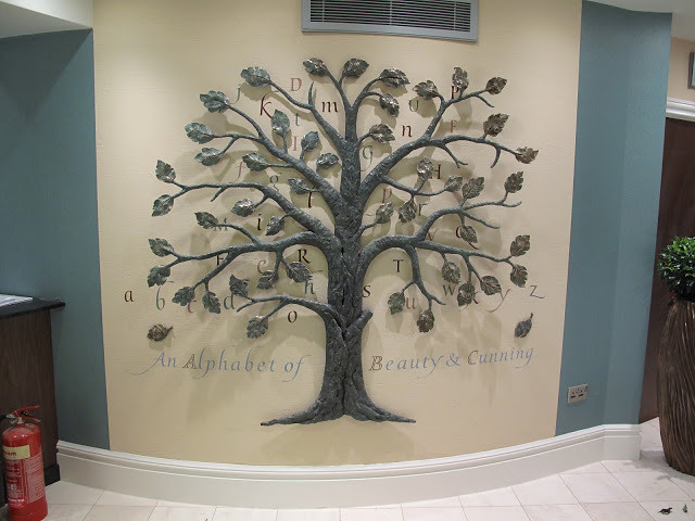Cast bronze tree with poetry by Linda France.